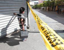 Una balacera en la Sexta Avenida con saldo mortal evidenció que persiste el peligro en este concurrido sector de la zona 1. (Foto Prensa Libre: Hemeroteca PL)