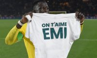 """Nantes' Guinean defender Abdoulaye Toure  holds a tee-shirt wich reads """"EMI (Nantes' Argentinian forward Emilianio Sala) we love you"""", during a tribute ceremony for Nantes' Argentinian forward Emilianio Sala at the end of the French L1 football match between FC Nantes and AS Saint Etienne (ASSE) at the La Beaujoire stadium in Nantes, western France on January 30, 2019. - A plane transporting Sala -- who had just been transferred from French team Nantes to Premier League club Cardiff City in a 17-million-euro ($19.3-million) move -- and British pilot Dave Ibbotson vanished from radar around 20 kilometres (12 miles) north of the Channel island of Guernsey on January 21. (Photo by SEBASTIEN SALOM GOMIS / AFP)"""