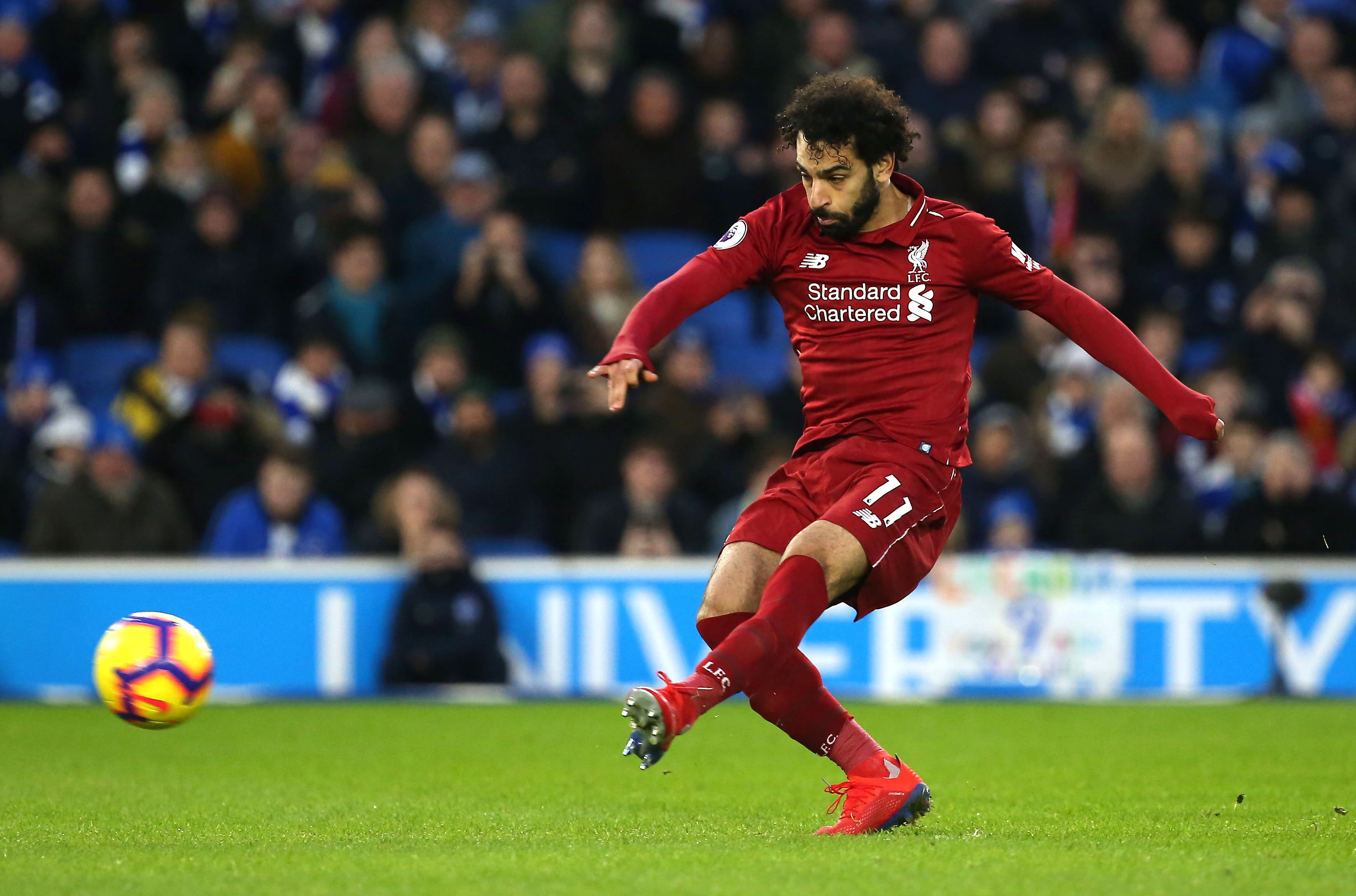 JB 3. Brighton (United Kingdom), 12/01/2019.- Liverpool's Mohamed Salah scores the opening goal during the English Premier League soccer match between Brighton Hove Albion and Liverpool at the Amex Stadium in Brighton, Britain, 12 January 2019. EFE/EPA/James Boardman EDITORIAL USE ONLY. No use with unauthorized audio, video, data, fixture lists, club/league logos or 'live' services. Online in-match use limited to 120 images, no video emulation. No use in betting, games or single club/league/player publications