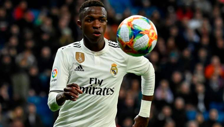 Real Madrid's Brazilian forward Vinicius Junior eyes the ball during the Spanish Copa del Rey (King's Cup) quarter-final first leg football match between Real Madrid CF and Girona FC at the Santiago Bernabeu stadium in Madrid on January 24, 2019. (Photo by JAVIER SORIANO / AFP)