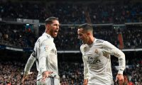 Real Madrid's Spanish defender Sergio Ramos (L) Real Madrid's Spanish midfielder Lucas Vazquez after scoring  during the Spanish Copa del Rey (King's Cup) quarter-final first leg football match between Real Madrid CF and Girona FC at the Santiago Bernabeu stadium in Madrid on January 24, 2019. (Photo by JAVIER SORIANO / AFP)