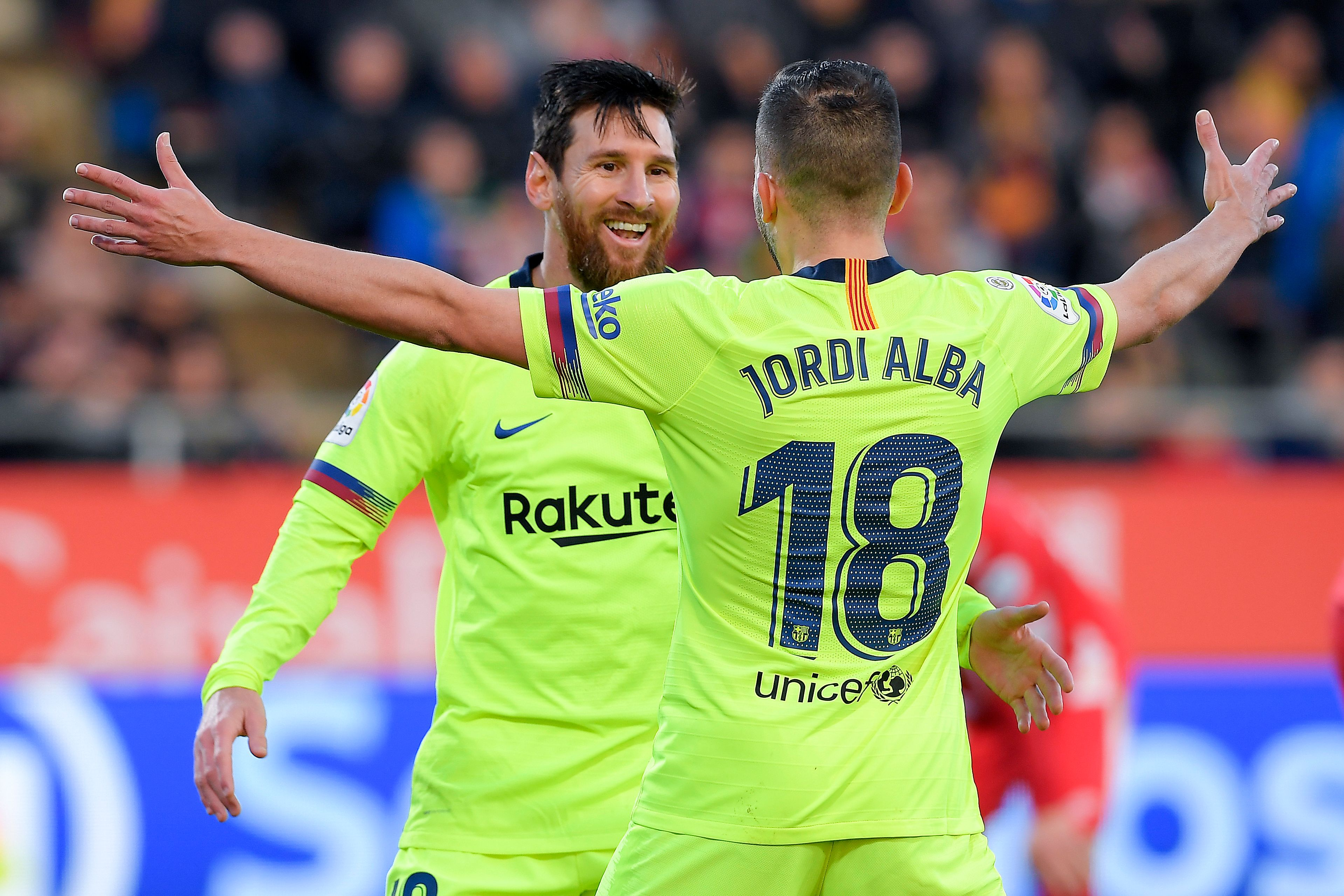 Barcelona's Argentinian forward Lionel Messi (L) celebrates with Barcelona's Spanish defender Jordi Alba after scoring a goal during the Spanish league football match between Girona FC and FC Barcelona at the Montilivi stadium in Girona on January 27, 2019. (Photo by LLUIS GENE / AFP)