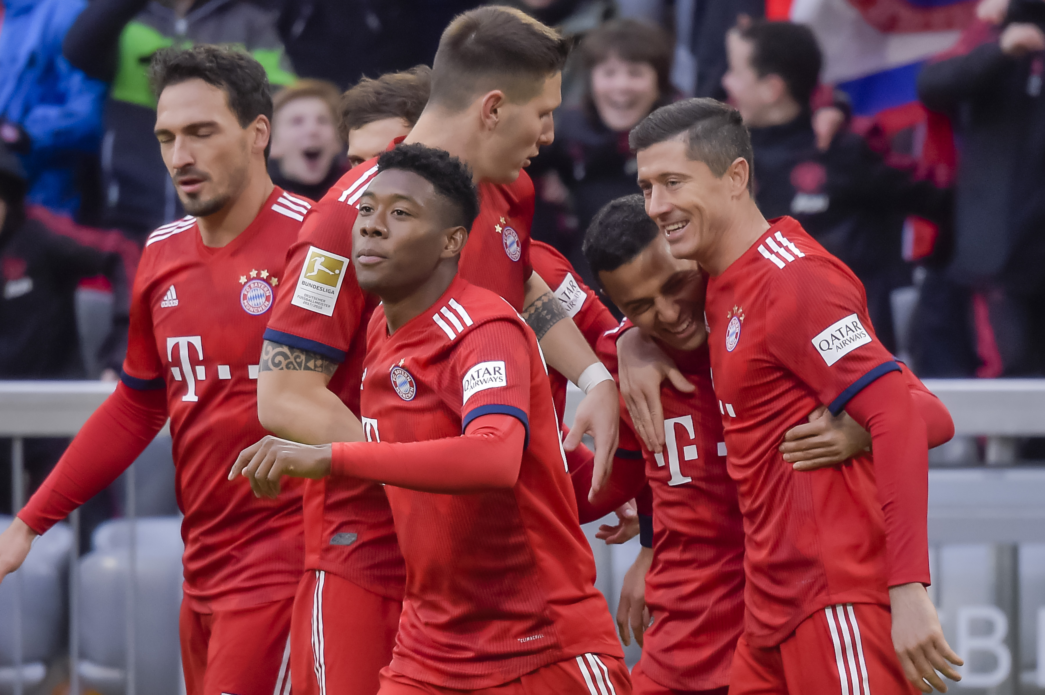 Players of Bayern Munich celebrate the first goal  during the German first division Bundesliga football match FC Bayern Munich vs VfB Stuttgart in the southern German city of Munich on January 27, 2019. (Photo by Guenter SCHIFFMANN / AFP)