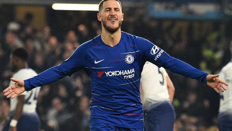 Chelsea's Belgian midfielder Eden Hazard celebrates after scoring their second goal during the English League Cup semi-final second-leg football match between Chelsea and Tottenham Hotspur at Stamford Bridge in London on January 24, 2019. (Photo by Glyn KIRK / AFP) / RESTRICTED TO EDITORIAL USE. No use with unauthorized audio, video, data, fixture lists, club/league logos or 'live' services. Online in-match use limited to 120 images. An additional 40 images may be used in extra time. No video emulation. Social media in-match use limited to 120 images. An additional 40 images may be used in extra time. No use in betting publications, games or single club/league/player publications. /