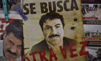 """A poster with the face of Mexican drug lord Joaquin """"El Chapo"""" Guzman, reading """"Wanted, Again"""", is displayed at a newsstand in one Mexico City's major bus terminals on July 13, 2015, a day after the government informed of the escape of the drug kingpin from a maximum-security prison. Mexican security forces scrambled Monday to save face and recapture """"El Chapo"""" as authorities investigated whether guards helped him escape prison through a tunnel under his cell.   AFP PHOTO / YURI CORTEZ"""