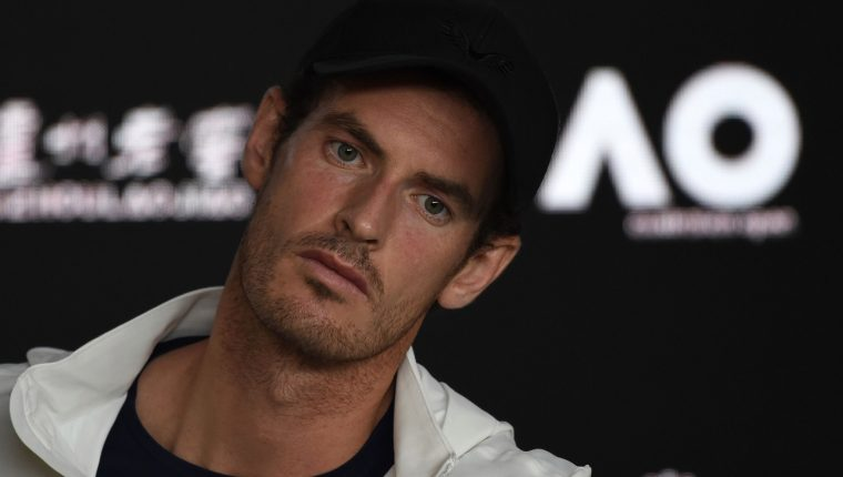 Britain's Andy Murray addresses media representatives at a press conference after defeat in his first round men's singles match against Spain's Roberto Bautista Agut on day one of the Australian Open tennis tournament in Melbourne early January 15, 2019. (Photo by Greg Wood / AFP) / -- IMAGE RESTRICTED TO EDITORIAL USE - STRICTLY NO COMMERCIAL USE --