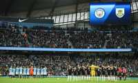 Teams wear black armbands and observe a moments silence in honour of missing Premier League player Emiliano Sala before kick off of the English FA Cup fourth round football match between Manchester City and Burnley at the Etihad Stadium in Manchester, north west England, on January 26, 2019. (Photo by Oli SCARFF / AFP) / RESTRICTED TO EDITORIAL USE. No use with unauthorized audio, video, data, fixture lists, club/league logos or 'live' services. Online in-match use limited to 120 images. An additional 40 images may be used in extra time. No video emulation. Social media in-match use limited to 120 images. An additional 40 images may be used in extra time. No use in betting publications, games or single club/league/player publications. /