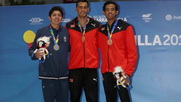 Luis Carlos Martínez ganó la medalla de plata en la prueba masculina de 50 metros mariposa en los Juegos Centroamericanos y del Caribe de Barranquilla 2018. (Foto Prensa Libre: Carlos Vicente)