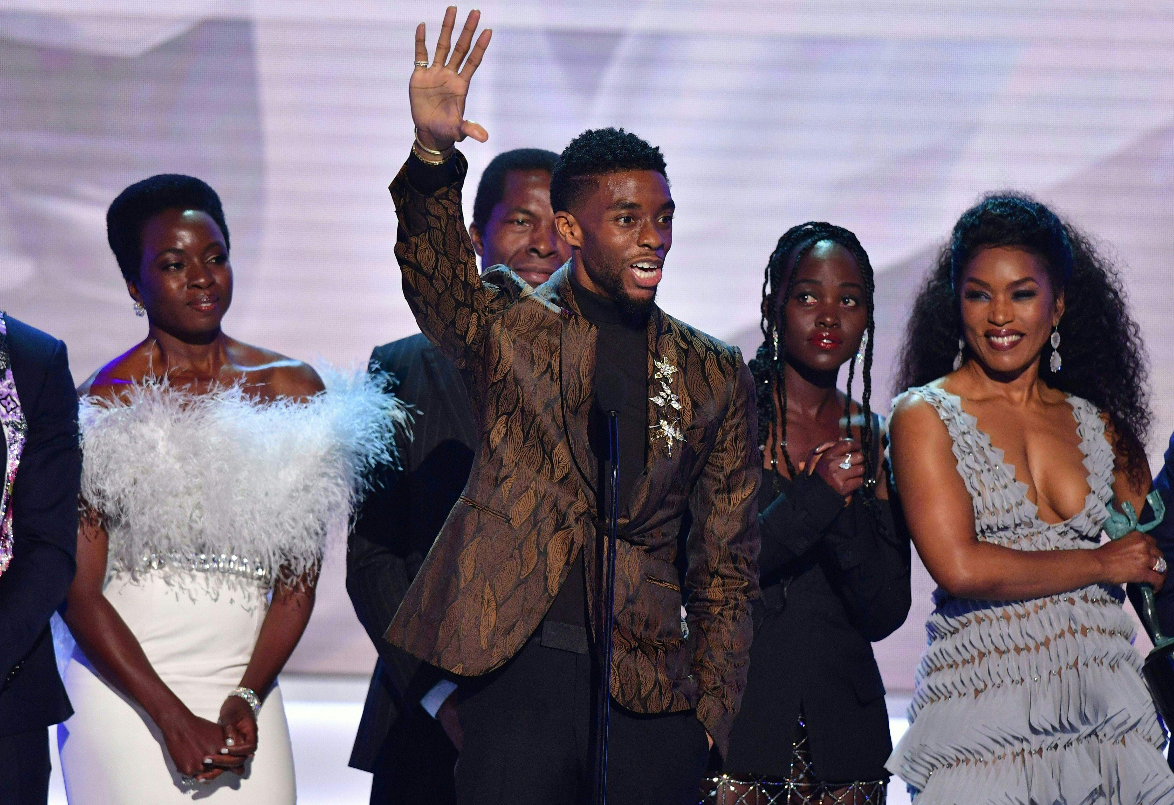 "(L-R) Danai Gurira, Chadwick Boseman, Lupita Nyong'o, Angela Bassett and the cast of ""Black Panther"" accept the award for best Cast In A Motion Picture, during the 25th Annual Screen Actors Guild Awards show at the Shrine Auditorium in Los Angeles on January 27, 2019. (Photo by Frederic J. BROWN / AFP)"