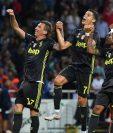 Mario Mandzukic, Cristiano Ronaldo y Douglas Costa celebran después de haber vencido al Parma. (Foto Prensa Libre: AFP).