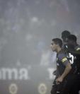 Los jugadores del Sevilla sufrieron en su visita a Leganés y cedieron el subliderato. (Foto Prensa Libre: AFP)