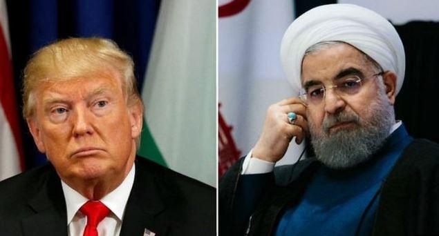 """El presidente Rouhani (a la derecha) dice que irán está listo para """"confrontar"""" las decisiones hechas por Trump. (EPA)"""