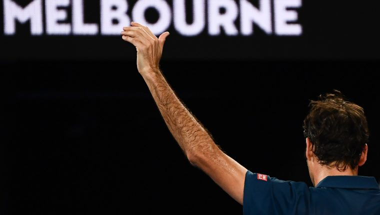 Switzerland's Roger Federer gestures to the crowd as he leaves the court after his defeat against Greece's Stefanos Tsitsipas during their men's singles match on day seven of the Australian Open tennis tournament in Melbourne on January 20, 2019. (Photo by Jewel SAMAD / AFP) / -- IMAGE RESTRICTED TO EDITORIAL USE - STRICTLY NO COMMERCIAL USE --
