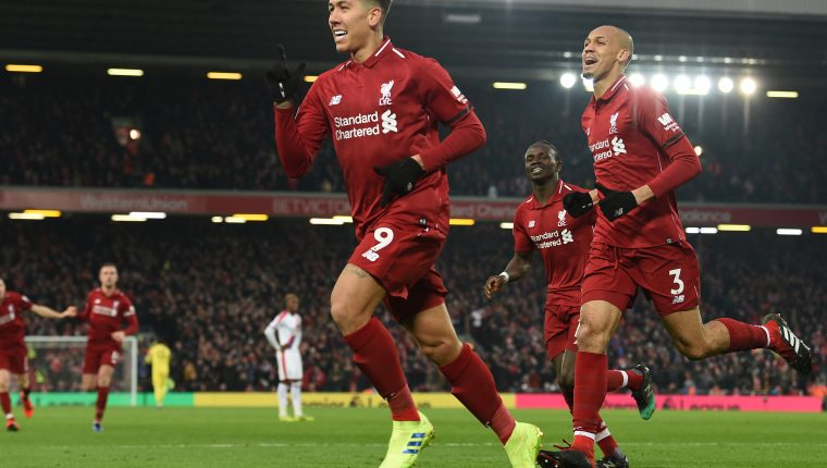 Liverpool's Brazilian midfielder Roberto Firmino (C) celebrates with teammates after scoring their second goal during the English Premier League football match between Liverpool and Crystal Palace at Anfield in Liverpool, north west England on January 19, 2019. (Photo by Paul ELLIS / AFP) / RESTRICTED TO EDITORIAL USE. No use with unauthorized audio, video, data, fixture lists, club/league logos or 'live' services. Online in-match use limited to 120 images. An additional 40 images may be used in extra time. No video emulation. Social media in-match use limited to 120 images. An additional 40 images may be used in extra time. No use in betting publications, games or single club/league/player publications. /