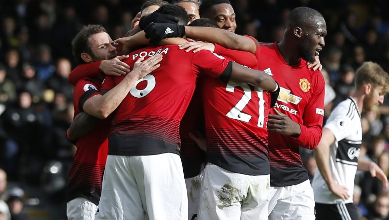Manchester United's French midfielder Paul Pogba (2nd L) celebrates with teammates after scoring their third goal from the penalty spot during the English Premier League football match between Fulham and Manchester United at Craven Cottage in London on February 9, 2019. (Photo by Ian KINGTON / AFP) / RESTRICTED TO EDITORIAL USE. No use with unauthorized audio, video, data, fixture lists, club/league logos or 'live' services. Online in-match use limited to 120 images. An additional 40 images may be used in extra time. No video emulation. Social media in-match use limited to 120 images. An additional 40 images may be used in extra time. No use in betting publications, games or single club/league/player publications. /