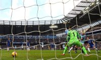 Manchester City's Argentinian striker Sergio Aguero (2R) scores his team's third goal past Chelsea's Spanish goalkeeper Kepa Arrizabalaga during the English Premier League football match between Manchester City and Burnley at the Etihad Stadium in Manchester, north west England, on February 10, 2019. (Photo by Oli SCARFF / AFP) / RESTRICTED TO EDITORIAL USE. No use with unauthorized audio, video, data, fixture lists, club/league logos or 'live' services. Online in-match use limited to 120 images. An additional 40 images may be used in extra time. No video emulation. Social media in-match use limited to 120 images. An additional 40 images may be used in extra time. No use in betting publications, games or single club/league/player publications. /