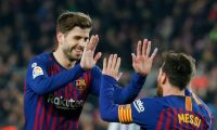 Barcelona's Argentinian forward Lionel Messi (R) celebrates with Barcelona's Spanish defender Gerard Pique after scoring a goal during the Spanish League football match between Barcelona and Real Valladolid at the Camp Nou stadium in Barcelona on February 16, 2019. (Photo by Pau Barrena / AFP)