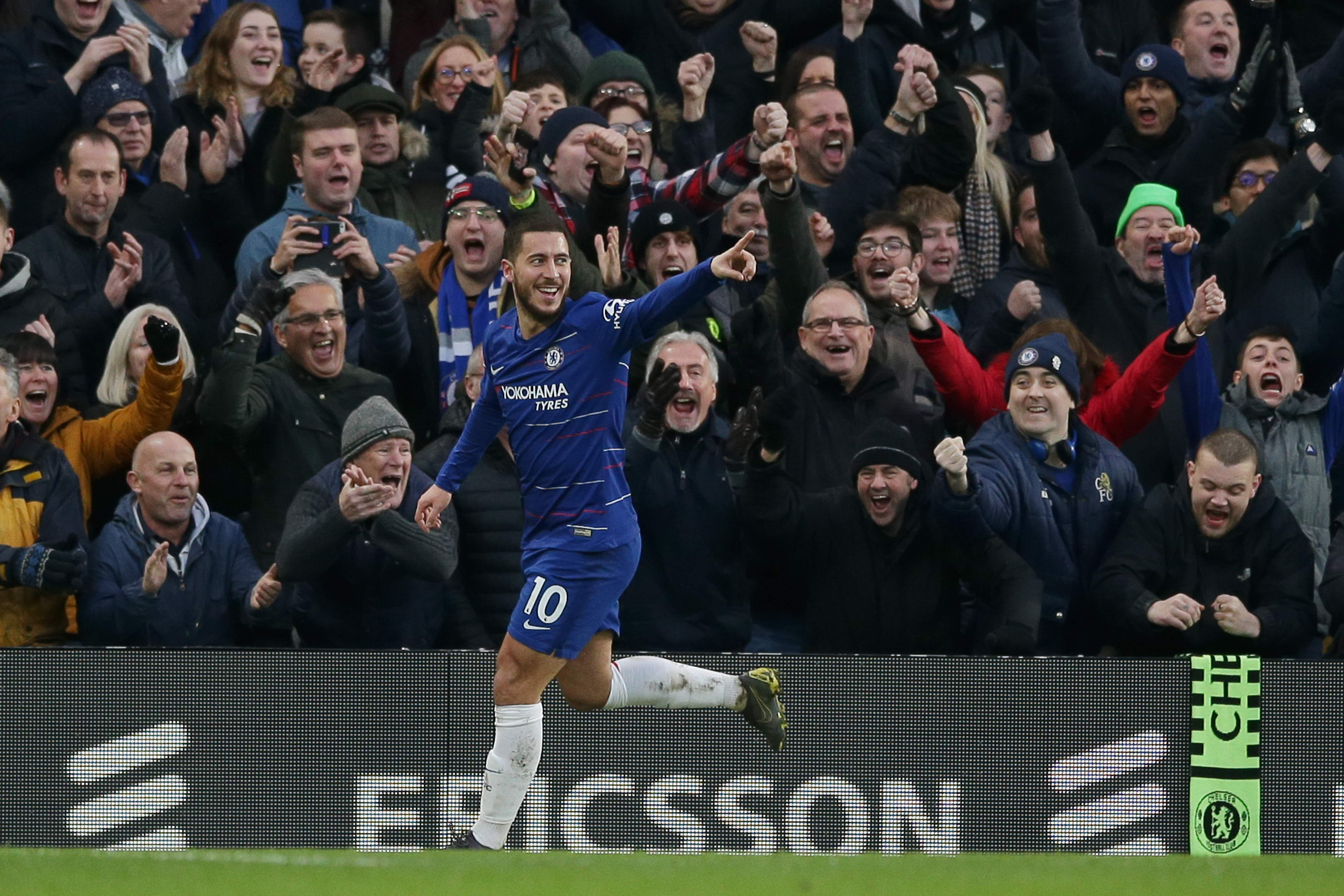 Chelsea's Belgian midfielder Eden Hazard celebrates scoring their third goal during the English Premier League football match between Chelsea and Huddersfield Town at Stamford Bridge in London on February 2, 2019. (Photo by Daniel LEAL-OLIVAS / AFP) / RESTRICTED TO EDITORIAL USE. No use with unauthorized audio, video, data, fixture lists, club/league logos or 'live' services. Online in-match use limited to 120 images. An additional 40 images may be used in extra time. No video emulation. Social media in-match use limited to 120 images. An additional 40 images may be used in extra time. No use in betting publications, games or single club/league/player publications. /