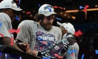Center for the New England Patriots David Andrews holds the trophy after winning Super Bowl LIII against the Los Angeles Rams at Mercedes-Benz Stadium in Atlanta, Georgia, on February 3, 2019. (Photo by TIMOTHY A. CLARY / AFP)