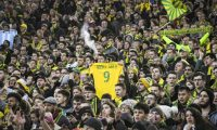 """A FC Nantes supporter holds a #9 jersey reading """"Thank you Sala"""" in memory of late Argentinian forward Emiliano Sala prior to the French L1 football match between FC Nantes and Nimes Olympique at the La Beaujoire stadium in Nantes, western France on February 10, 2019. - FC Nantes football club announced on February 8, 2019 that it will freeze the #9 jersey as a tribute to Cardiff City and former Nantes footballer Emiliano Sala who died in a plane crash in the English Channel on January 21, 2019. (Photo by LOIC VENANCE / AFP)"""