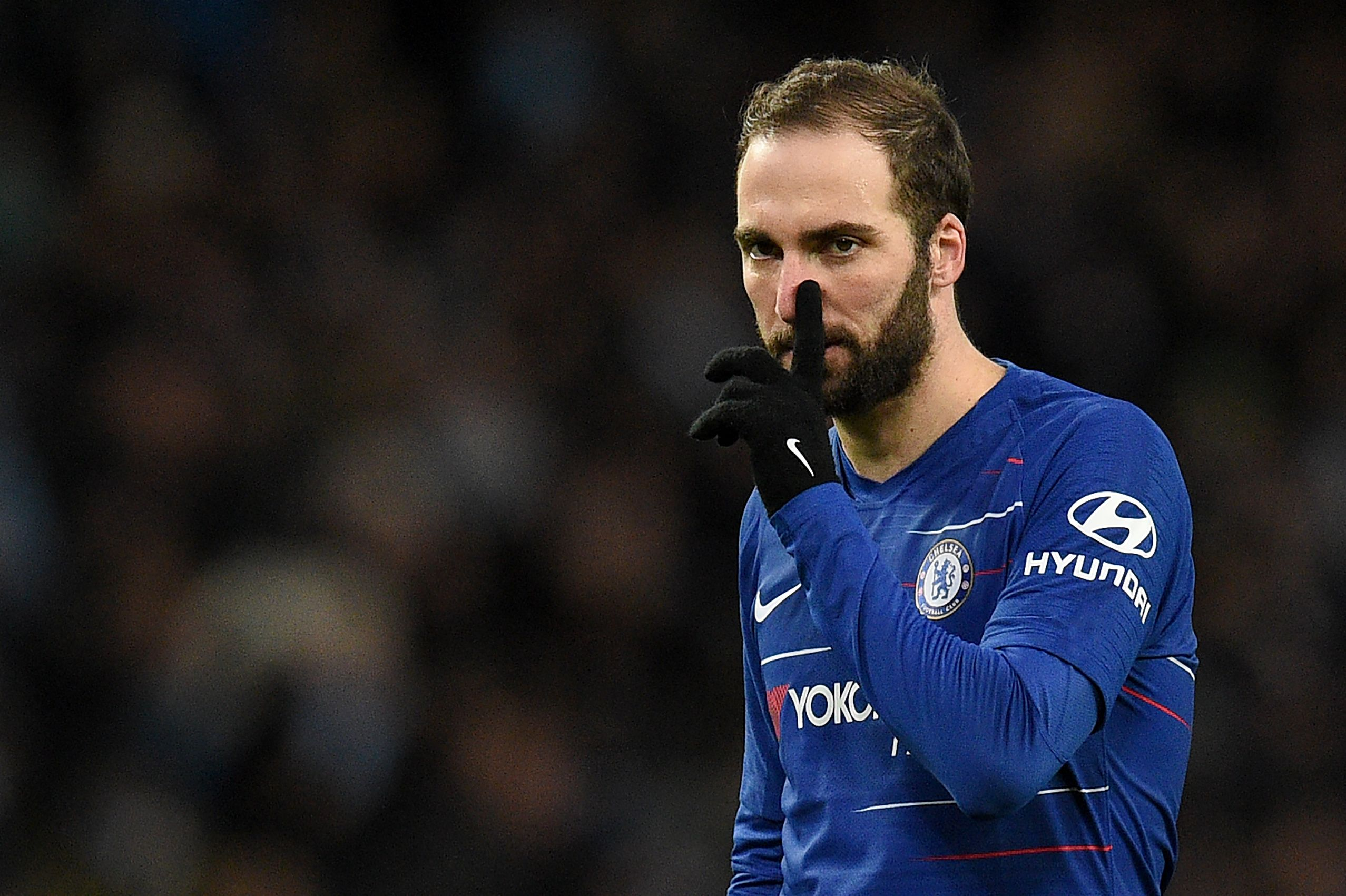 Chelsea's Argentinian striker Gonzalo Higuain gestures the English Premier League football match between Manchester City and Burnley at the Etihad Stadium in Manchester, north west England, on February 10, 2019. (Photo by Oli SCARFF / AFP) / RESTRICTED TO EDITORIAL USE. No use with unauthorized audio, video, data, fixture lists, club/league logos or 'live' services. Online in-match use limited to 120 images. An additional 40 images may be used in extra time. No video emulation. Social media in-match use limited to 120 images. An additional 40 images may be used in extra time. No use in betting publications, games or single club/league/player publications. /