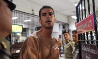 (FILES) In this file photo taken on February 04, 2019 Hakeem al-Araibi, a Bahraini refugee and Australian resident, is escorted to a courtroom in Bangkok. - Thailand has ended the extradition poroceedings against refugee footballer Hakeem al-Araibi on February 11, a prosecutor said. (Photo by Lillian SUWANRUMPHA / AFP)