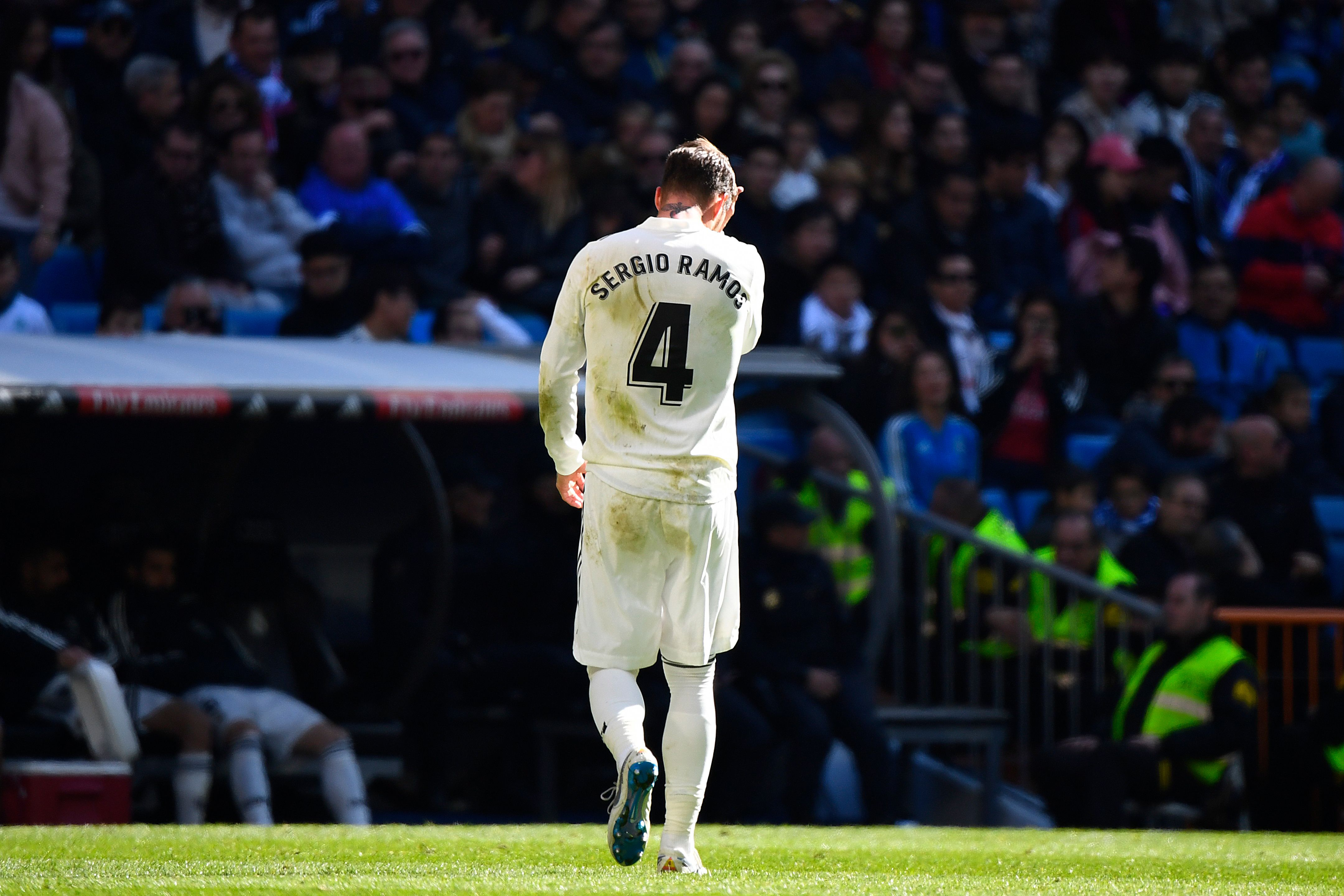 Real Madrid's Spanish defender Sergio Ramos walks off the pitch after receiving a red card during the Spanish League football match between Real Madrid and Girona at the Santiago Bernabeu stadium in Madrid on February 17, 2019. (Photo by GABRIEL BOUYS / AFP)