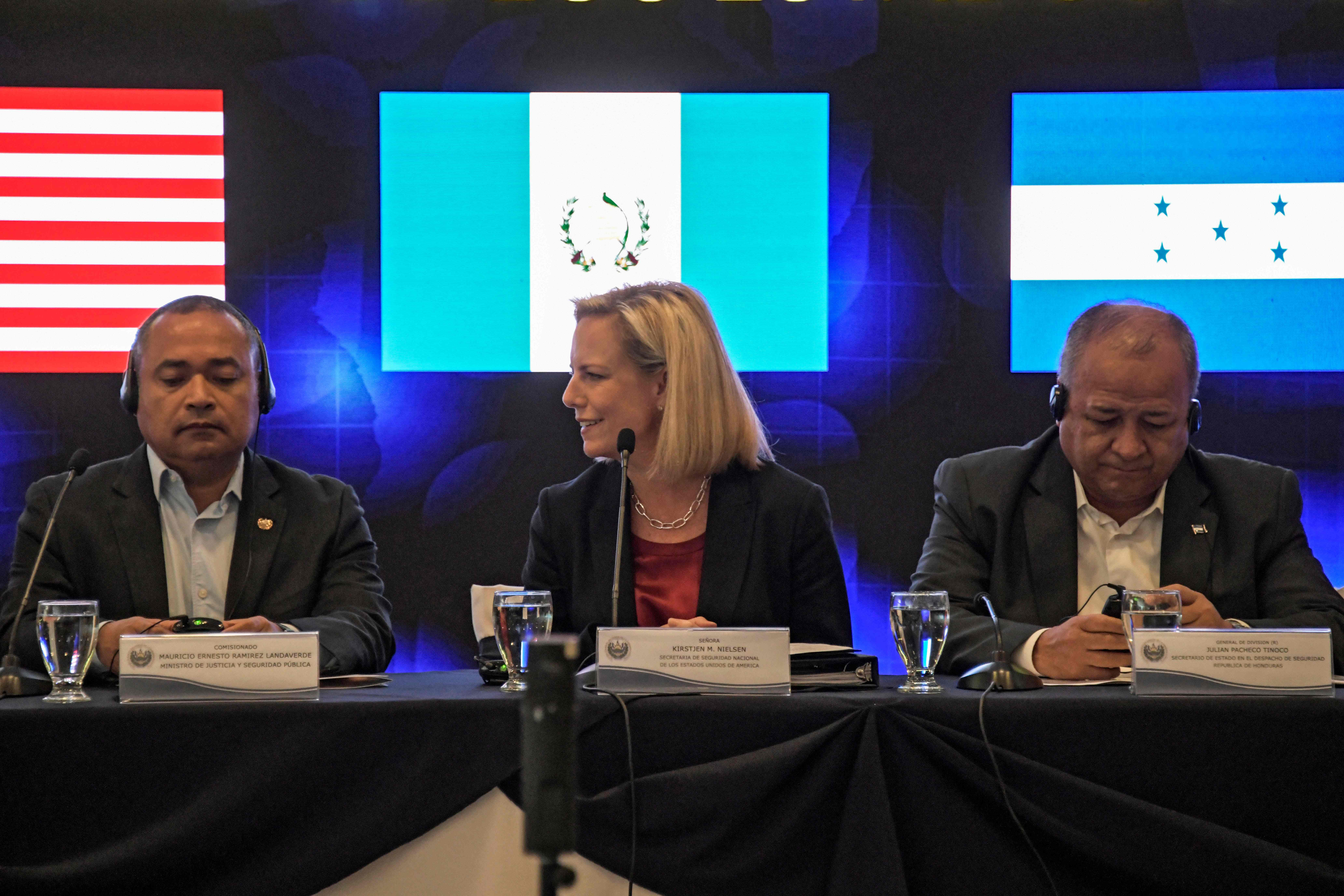 """United States Secretary of Homeland Security (DHS) Kirstjen Nielsen (C) Honduran Security Minister Julian Pacheco Tinoco (R) and El Salvador's Security Minister Mauricio Ramirez Landaverde, attend the opening of the fourth meeting of security ministers of the """"Northern Triangle"""" in San Salvador, on February 20, 2019. - Nielsen called on Guatemala, El Salvador and Honduras security ministers to stop new caravans of migrants who illegally try to reach the US. (Photo by MARVIN RECINOS / AFP)"""