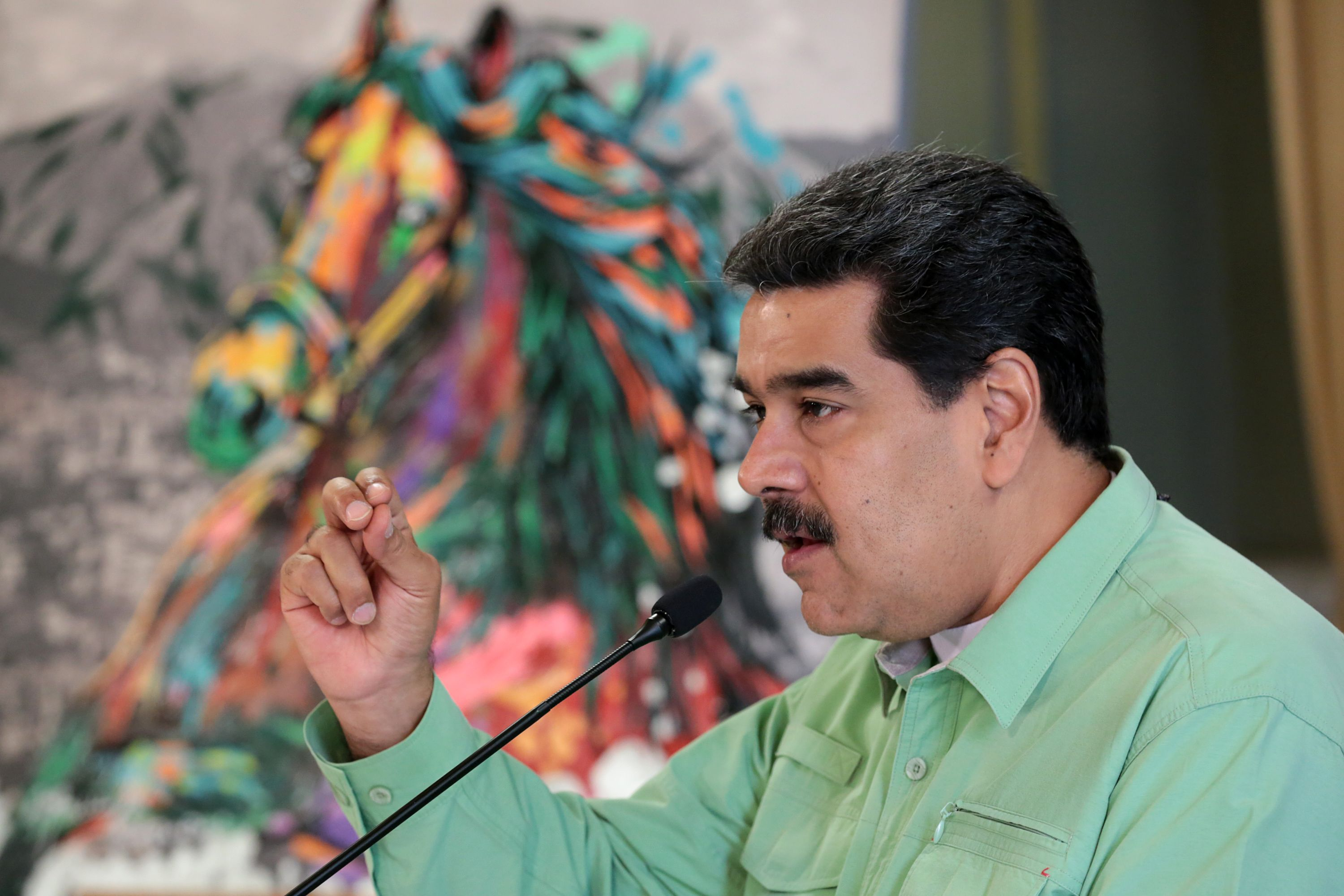 """This handout picture released by the Venezuelan presidency press office shows Venezuelan President Nicolas Maduro during a meeting with doctors in Caracas, Venezuela on February 21, 2019. - President Nicolas Maduro said Venezuela would shut its border with Brazil on Thursday """"until further notice"""" amid a tense standoff with opposition leader Juan Guaido over allowing in humanitarian aid. (Photo by HO / Venezuelan Presidency / AFP) / RESTRICTED TO EDITORIAL USE-MANDATORY CREDIT """"AFP PHOTO/VENEZUELAN PRESIDENCY/HO"""" NO MARKETING NO ADVERTISING CAMPAIGNS-DISTRIBUTED AS A SERVICE TO CLIENTS-GETTY OUT"""