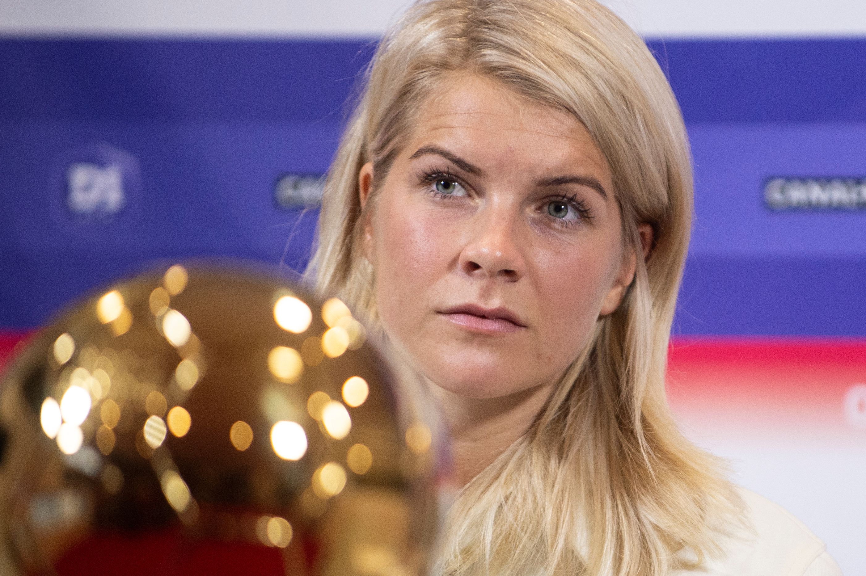 (FILES) In this file photo taken on December 4, 2018, Lyon's Norwegian forward Ada Hegerberg, winner of the 2018 Women's Ballon d'Or award for best player of the year, poses with the trophy during a press conference at the Groupama training center in Lyon, central eastern France. - She first took to the pitch as a pesky little girl who followed her big sister everywhere. Today she is the top female footballer in the world, crowned with the first women's Ballon d'Or. (Photo by ROMAIN LAFABREGUE / AFP)