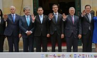 """(L to R) US Vice President Mike Pence, Colombia's Foreign Minister Carlos Holmes Trujillo, Guatemalan President Jimmy Morales, Venezuelan opposition leader and self-declared acting president Juan Guaido, Colombian President Ivan Duque and Panama's President Juan Carlos Varela pose for a family picture during the Lima's Group Foreign Affairs Ministers 11th meeting at the Foreign Ministry in Bogota, on February 25, 2019. - US Vice President Mike Pence passed on a message from Donald Trump to Venezuela's opposition leader Juan Guaido on Monday, telling him """"we are with you 100 percent."""" Pence and Guaido met in Colombia's capital during a meeting of regional allies to discuss their next move in response to the crisis in Venezuela. (Photo by Diana Sanchez / AFP)"""