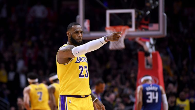 LOS ANGELES, CALIFORNIA - JANUARY 31: LeBron James #23 of the Los Angeles Lakers reacts to a basket from Lance Stephenson #6 during a 123-120 win over the LA Clippers at Staples Center on January 31, 2019 in Los Angeles, California. NOTE TO USER: User expressly acknowledges and agrees that, by downloading and or using this photograph, User is consenting to the terms and conditions of the Getty Images License Agreement.   Harry How/Getty Images/AFP == FOR NEWSPAPERS, INTERNET, TELCOS & TELEVISION USE ONLY ==