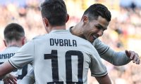 Juventus' Portuguese forward Cristiano Ronaldo (R) embraces Juventus' Argentine forward Paulo Dybala after Dybala opened the scoring during the Italian Serie A football match Bologna vs Juventus on February 24, 2019 at the Renato-Dall'Ara stadium in Bologna. (Photo by Tiziana FABI / AFP)