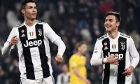 Juventus' Portuguese forward Cristiano Ronaldo (L) celebrates with Juventus' Argentine forward Paulo Dybala after scoring during the Italian Serie A football match Juventus vs Frosinone on February 15, 2019 at the Juventus stadium in Turin. (Photo by Marco BERTORELLO / AFP)