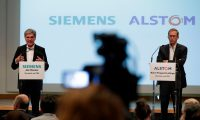 (FILES) In this file photo taken on September 27, 2017 German ICE train manufacturing company Siemens President and CEO, Joe Kaeser (L) and French railway transport company Alstom CEO, Henri Poupart-Lafarge speak during a press conference announcing the union between French railway transport company Alstom and Siemens. - The EU's powerful anti-trust authority on on February 2, 2019 halted a planned merger of the rail businesses of Germany's Siemens and France's Alstom, defying heavy pressure from Paris and Berlin. (Photo by Thomas SAMSON / AFP)