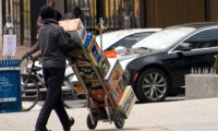 (FILES) In this file photo taken on December 8, 2017, A worker delivers food in Washington, DC. - US job creation saw another blockbuster month in January, adding 304,000 net new positions, blowing past the government shutdown, but that disruption helped to push the unemployment rate higher, the Labor Department reported on February 1, 2019. (Photo by mari matsuri / AFP)