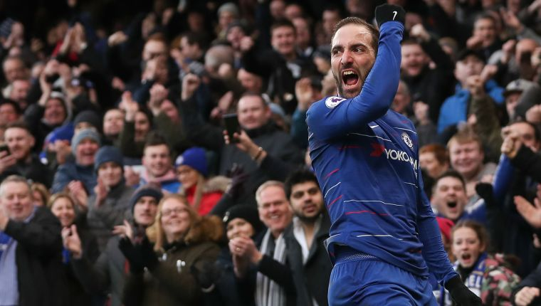 Chelsea's Argentinian striker Gonzalo Higuain celebrates scoring the opening goal during the English Premier League football match between Chelsea and Huddersfield Town at Stamford Bridge in London on February 2, 2019. (Photo by Daniel LEAL-OLIVAS / AFP) / RESTRICTED TO EDITORIAL USE. No use with unauthorized audio, video, data, fixture lists, club/league logos or 'live' services. Online in-match use limited to 120 images. An additional 40 images may be used in extra time. No video emulation. Social media in-match use limited to 120 images. An additional 40 images may be used in extra time. No use in betting publications, games or single club/league/player publications. /