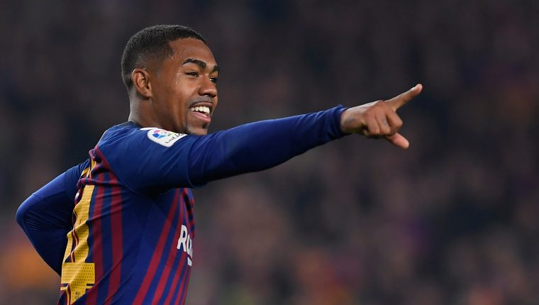 Barcelona's Brazilian midfielder Malcom celebrates after scoring during the Spanish Copa del Rey (King's Cup) semi-final first leg football match between FC Barcelona and Real Madrid CF at the Camp Nou stadium in Barcelona on February 6, 2019. (Photo by LLUIS GENE / AFP)