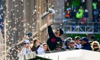 BOSTON, MASSACHUSETTS - FEBRUARY 05: Tom Brady #12 of the New England Patriots reacts as he holds the Vince Lombardi trophy during the Super Bowl Victory Parade on February 05, 2019 in Boston, Massachusetts.   Billie Weiss/Getty Images/AFP