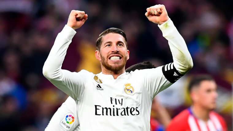 Real Madrid's Spanish defender Sergio Ramos celebrates at the end of the Spanish league football match between Club Atletico de Madrid and Real Madrid CF at the Wanda Metropolitano stadium in Madrid on February 9, 2019. (Photo by GABRIEL BOUYS / AFP)