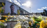 TOPSHOT - FC Nantes supporters gather in front of a portrait of late Argentinian forward Emiliano Sala prior to the French L1 football match between FC Nantes and Nimes Olympique at the La Beaujoire stadium in Nantes, western France on February 10, 2019. - FC Nantes football club announced on February 8, 2019 that it will freeze the #9 jersey as a tribute to Cardiff City and former Nantes footballer Emiliano Sala who died in a plane crash in the English Channel on January 21, 2019. (Photo by LOIC VENANCE / AFP)