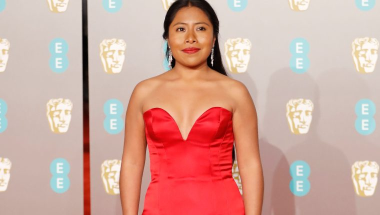 Mexican actress Yalitza Aparicio poses on the red carpet upon arrival at the BAFTA British Academy Film Awards at the Royal Albert Hall in London on February 10, 2019. (Photo by Tolga AKMEN / AFP)