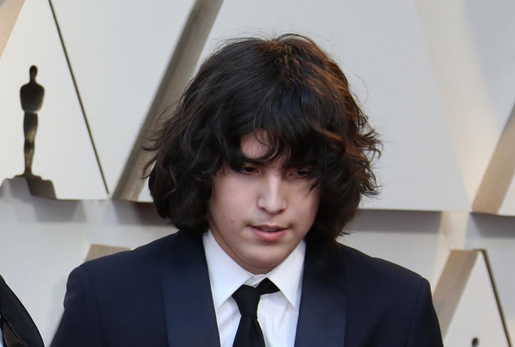 El comportamiento de Oslo, hijo de Alfonso Cuarón, despertó comentarios durante la celebración de los Premios Óscar 2019 (Foto Prensa Libre: EFE)
