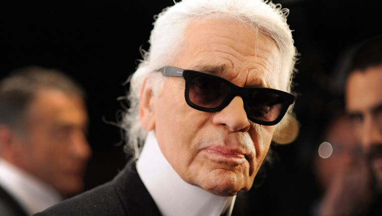 """Picture taken on November 20, 2012 shows German fashion designer Karl Lagerfeld during the opening of an exhibition titled """"The Little Black Jacket"""" in Berlin. - German fashion designer Karl Lagerfeld has died at the age of 85, it was announced on February 19, 2019. (Photo by Britta Pedersen / DPA / AFP) / Germany OUT"""