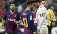 Barcelona's Argentinian forward Lionel Messi (2L) argues with Real Madrid's Spanish defender Sergio Ramos during the Spanish league football match between Real Madrid CF and FC Barcelona at the Santiago Bernabeu stadium in Madrid on March 2, 2019. (Photo by CURTO DE LA TORRE / AFP)