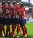 El Atlético de Madrid mantiene la distancia de siete puntos con el FC Barcelona. (Foto Prensa Libre: AFP)