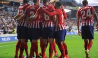 Atletico Madrid's players celebrate a goal during the Spanish league football match between Real Sociedad and Club Atletico de Madrid at the Anoeta stadium in San Sebastian on March 3, 2019. (Photo by ANDER GILLENEA / AFP)