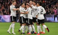 Germany's players celebrate after scoring during the UEFA Euro 2020 Group C qualification football match between The Netherlands and Germany at the Johan Cruyff Arena in Amsterdam on March 24, 2019. (Photo by EMMANUEL DUNAND / AFP)
