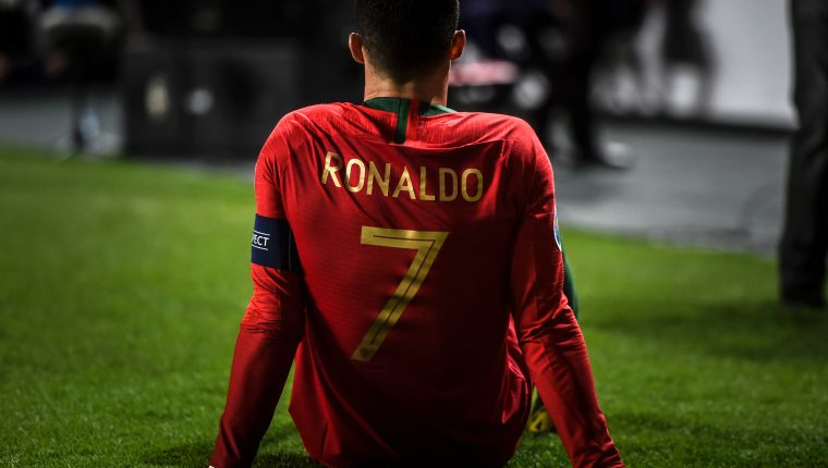 Portugal's forward Cristiano Ronaldo sits on the pitch during the Euro 2020 qualifying group B football match between Portugal and Serbia at the Luz stadium in Lisbon on March 25, 2019. (Photo by PATRICIA DE MELO MOREIRA / AFP)
