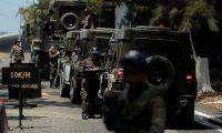 -FOTODELDÍA- GU5001.- CIUDAD DE GUATEMALA (GUATEMALA), 15/03/20019.- Varios vehículos militares que fueron donados a Guatemala por Estados Unidos como parte de su ayuda para el combate al narcotráfico fueron trasladados este viernes a las instalaciones de la Fuerza Aérea Guatemalteca (FAG) sin ninguna explicación oficial. EFE/Noé Pérez